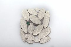 Silver and emerald brooch